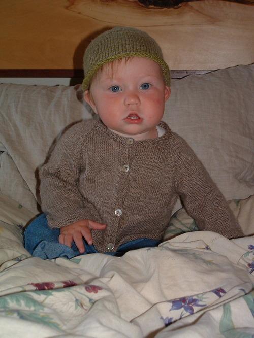 E's Tan Sweater & Stripey Hat